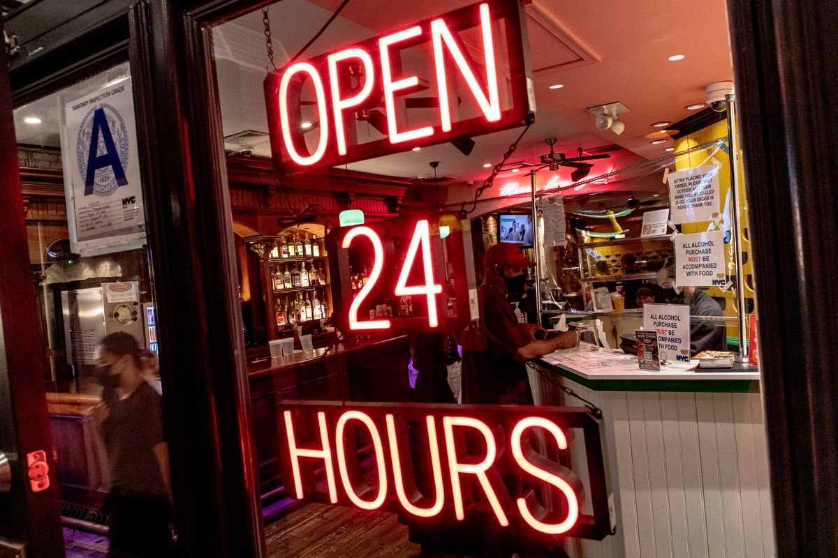 """The entryway at Empanada Mama reads """"Open 24 Hours"""""""