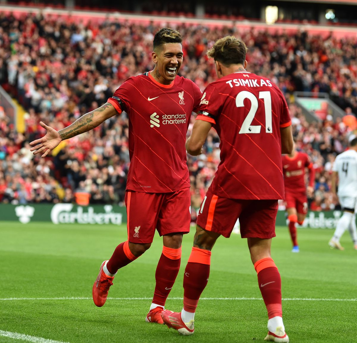 Roberto Firmino of Liverpool celebrates after scoring the second goal at Anfield on August 09, 2021 in Liverpool, England.