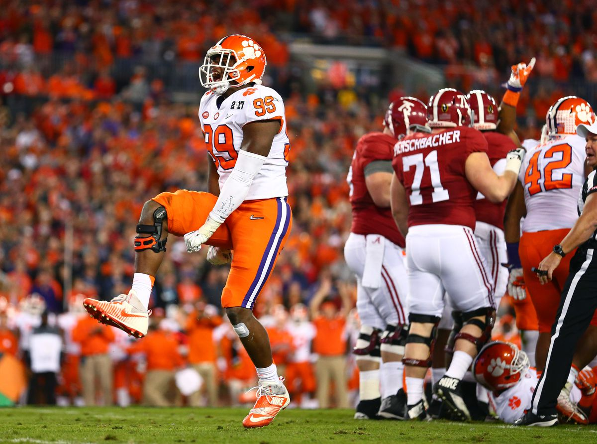 TAMPA, FL:  Clemson Tigers defensive end Clelin Ferrell (99) celebrates a tackle for loss against the Alabama Crimson Tide offense during the 2017 College Football Playoff National Championship Game at Raymond James Stadium.