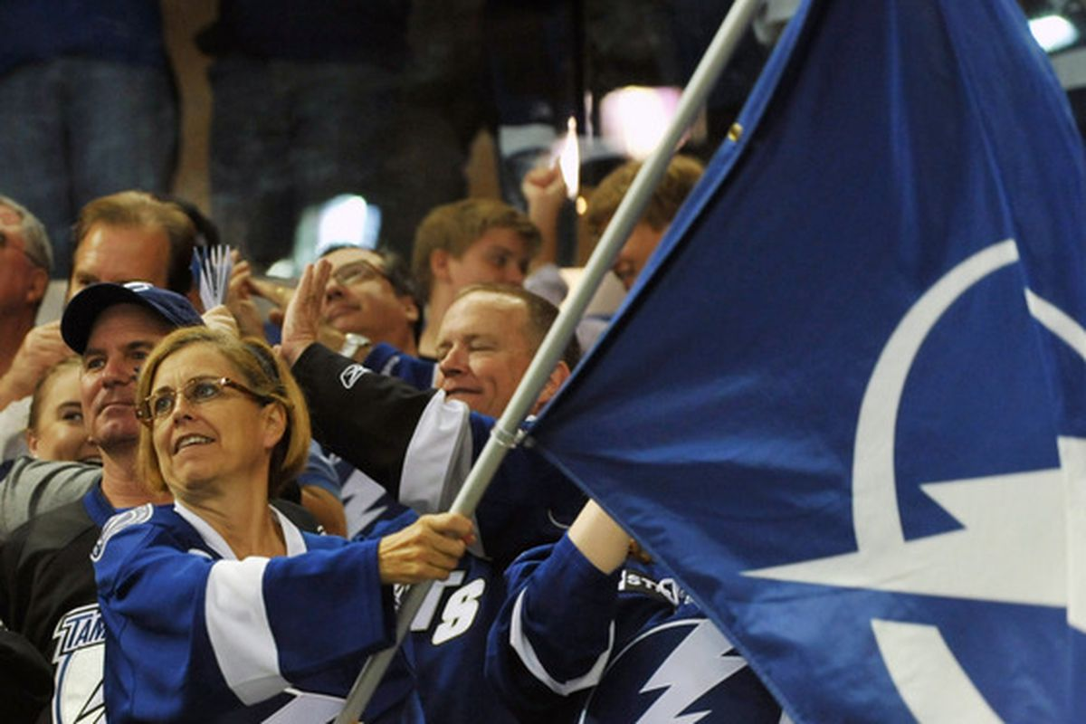 TAMPA, FL - OCTOBER 17:  A fan of the Tampa Bay Lightning waves a flag after a goal against the Florida Panthers October 17, 2011 at St. Pete Times Forum in Tampa, Florida. (Photo by Al Messerschmidt/Getty Images)