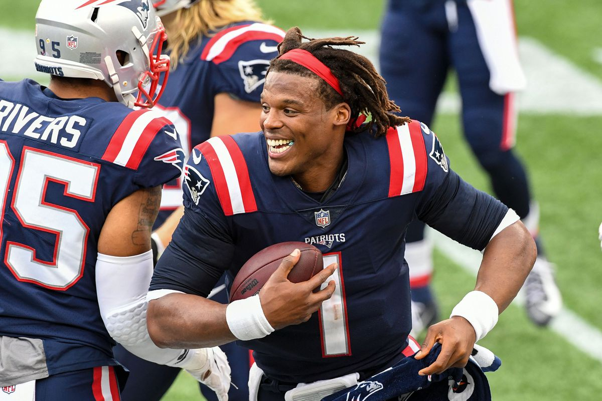 New England Patriots quarterback Cam Newton (1) celebrates after a touchdown scored by defensive end Deatrich Wise (not seen) against the Las Vegas Raiders during the fourth quarter at Gillette Stadium