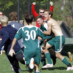 Olympus High School players celebrate their overtime win against Hillcrest High School in boys soccer in MIdvale, Friday, April 27, 2012.