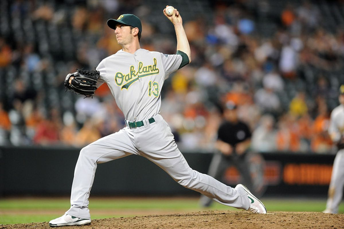 BALTIMORE - MAY 26:  Jerry Blevins #13 of the Oakland Athletics pitches against the Baltimore Orioles at Camden Yards on May 26, 2010 in Baltimore, Maryland.  (Photo by Greg Fiume/Getty Images)