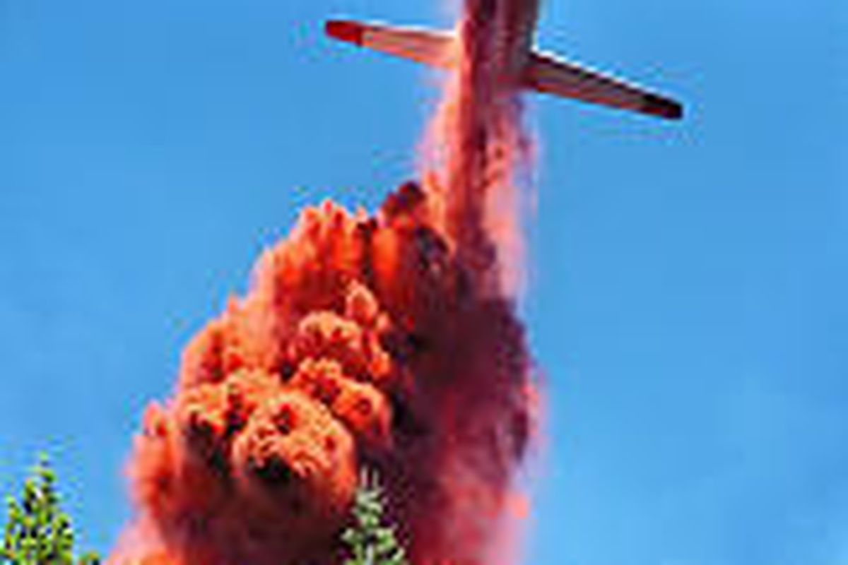 An air tanker drops retardant Aug. 23 on a fire near Medford, Ore. Most of the forest fires have been small.
