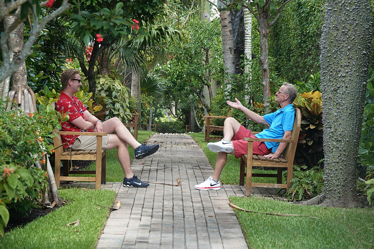 Peter Doocy, left, and his father Steve Doocy, both of Fox News, visit at the family home in Florida.