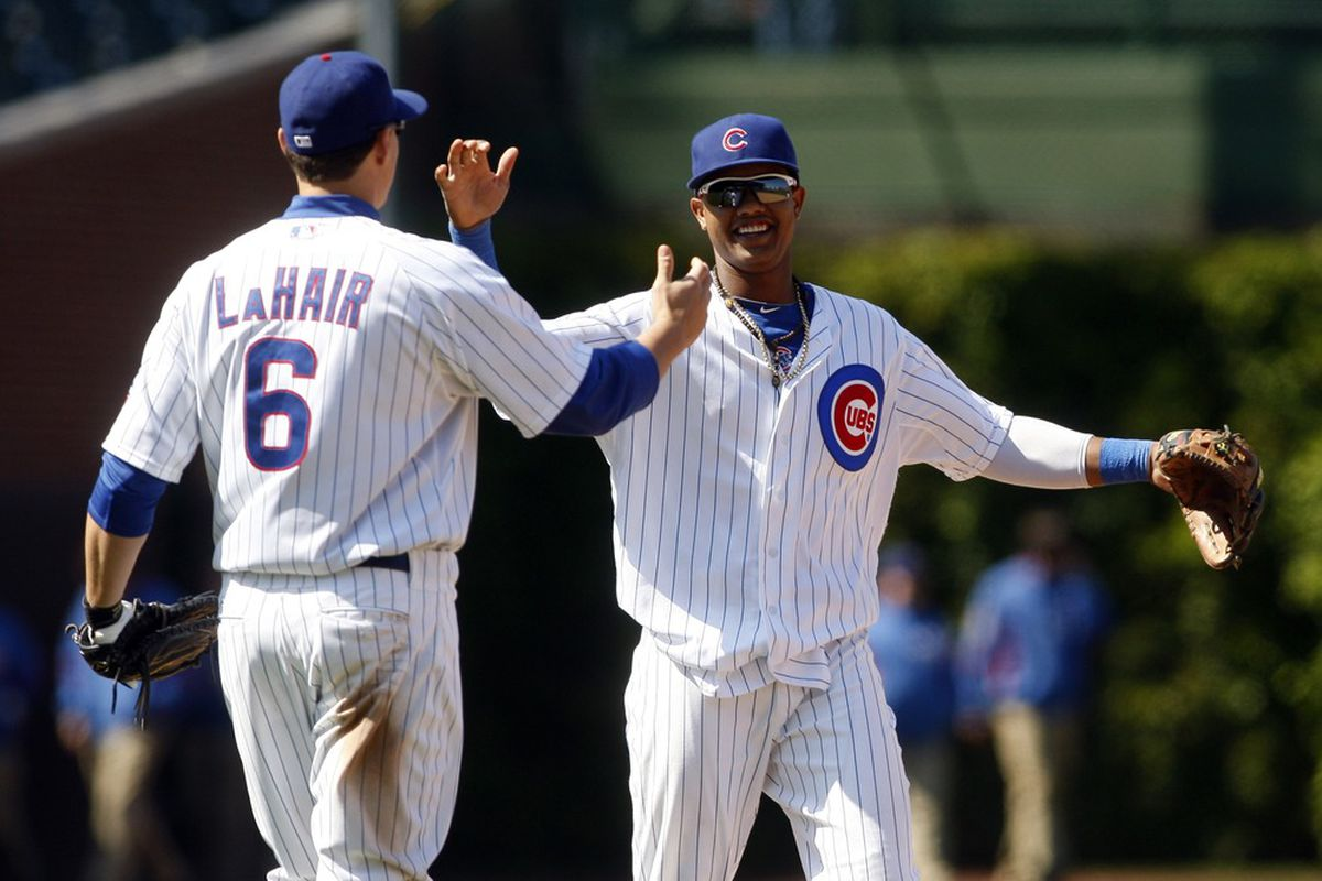 Chicago, IL, USA; Chicago Cubs first baseman Bryan LaHair celebrates with shortstop Starlin Castro after defeating the Atlanta Braves 1-0 at Wrigley Field. Credit: Jerry Lai-US PRESSWIRE