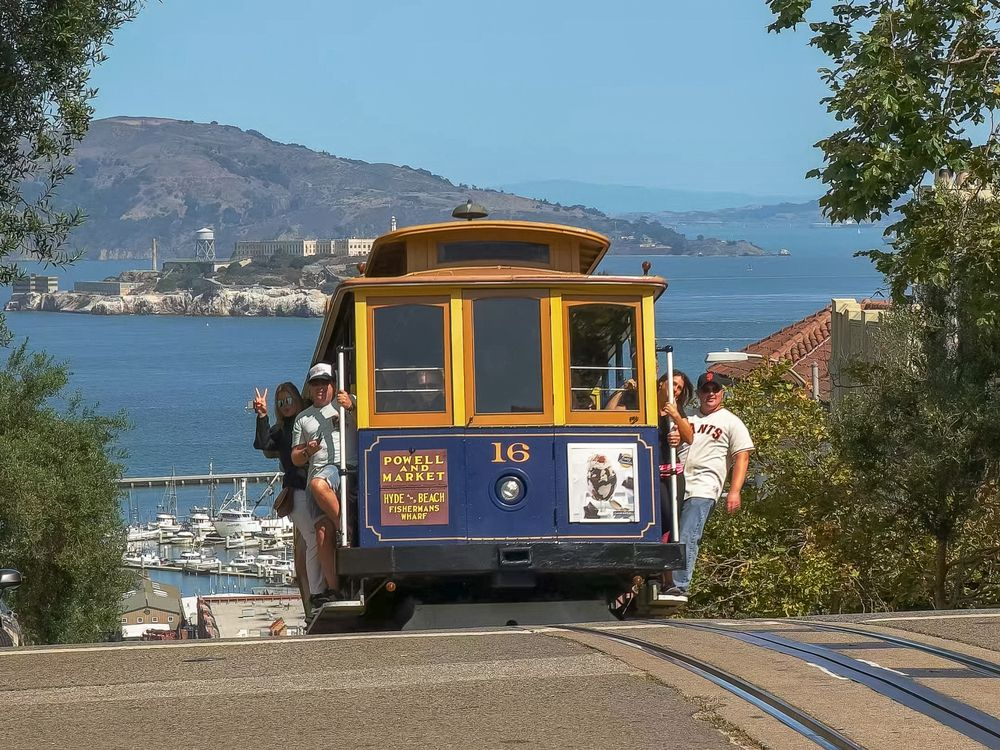 A cable car coming over a hill.