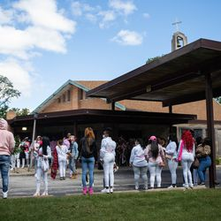 Mourners gather outside Abundant Living Christian Center in Dolton, Ill. during the wake and funeral of eight-year-old DaJore Wilson Friday morning, Sept. 18, 2020. Wilson was fatally shot in Canaryville Sept. 7.