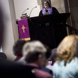 Associate Pastor Rev. Niki Atkinson sings with the congregation during Palm Sunday service at First Presbyterian Church in Greensburg, Pa., on Sunday, April 9, 2017.