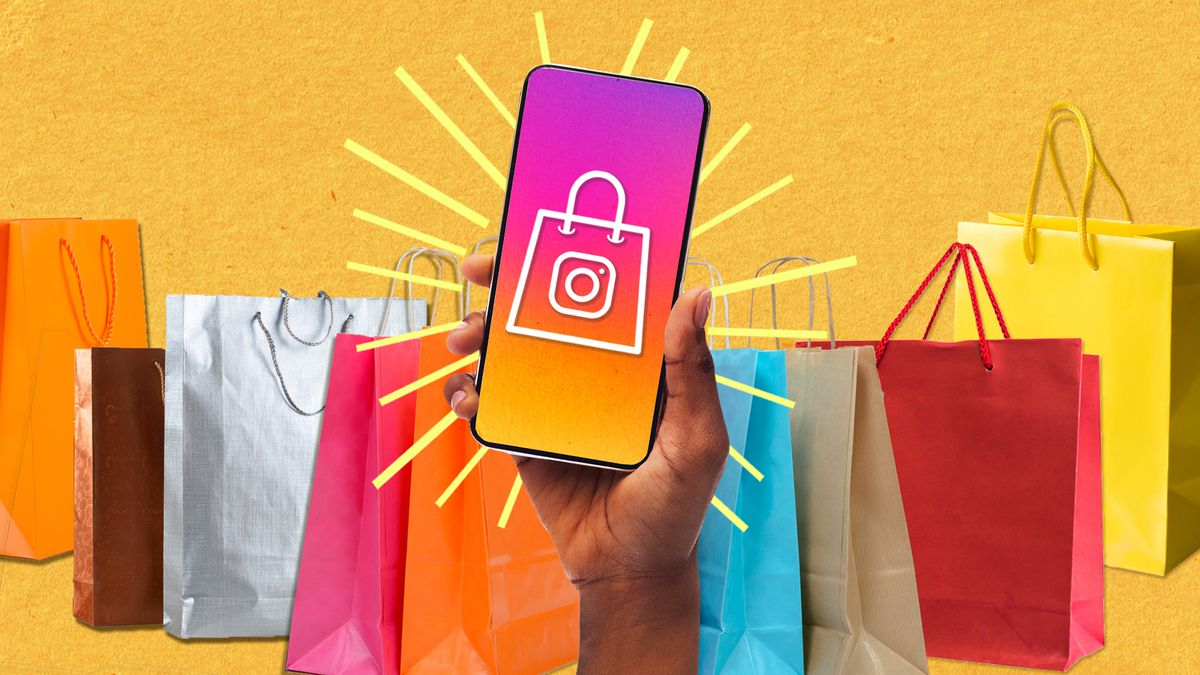 A hand holds up a phone in front of a backdrop of colorful shopping bags