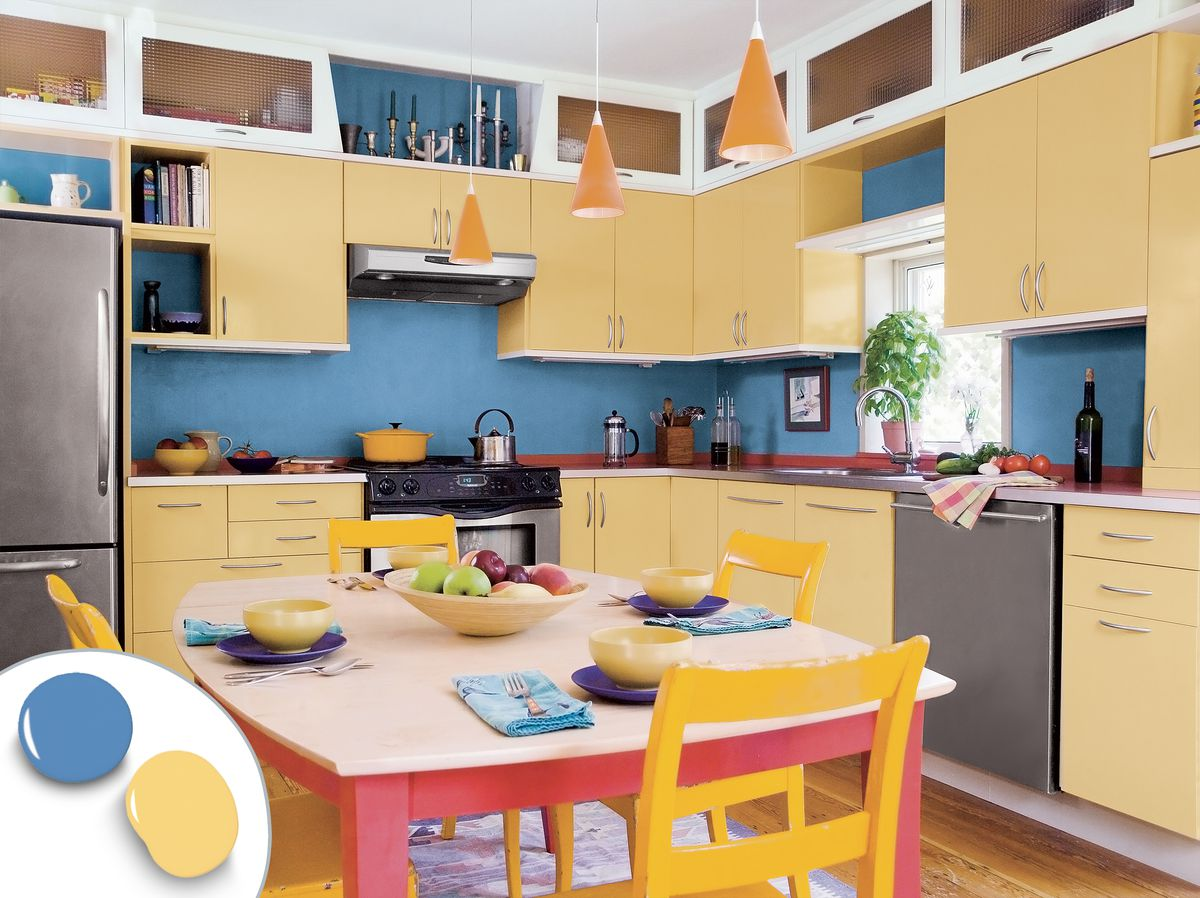 Bright kitchen color scheme with yellow cabinets, blue backsplash, and yellow chairs.