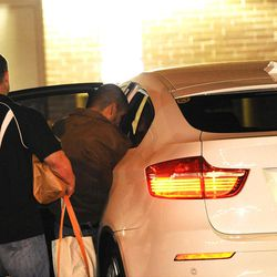 ADDS THAT THE MAN ACCOMPANYING ZIMMERMAN IS A BONDSMAN - George Zimmerman, right, gets into a vehicle moments after walking out of the intake building at the John E. Polk Correctional Facility with a bondsman on Sunday, April 22, 2012, in Sanford, Fla. Zimmerman posted bail on a $150,000 bond on a second degree murder charge in the February shooting death of 17 year-old Trayvon Martin In Sanford, Fla. (AP Photo/Brian Blanco)