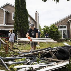 Dozens of volunteers help clean up damaged homes on Spice Circle near Nutmeg Lane in Naperville after a tornado ripped through the western suburbs overnight, Monday afternoon, June 21, 2021.