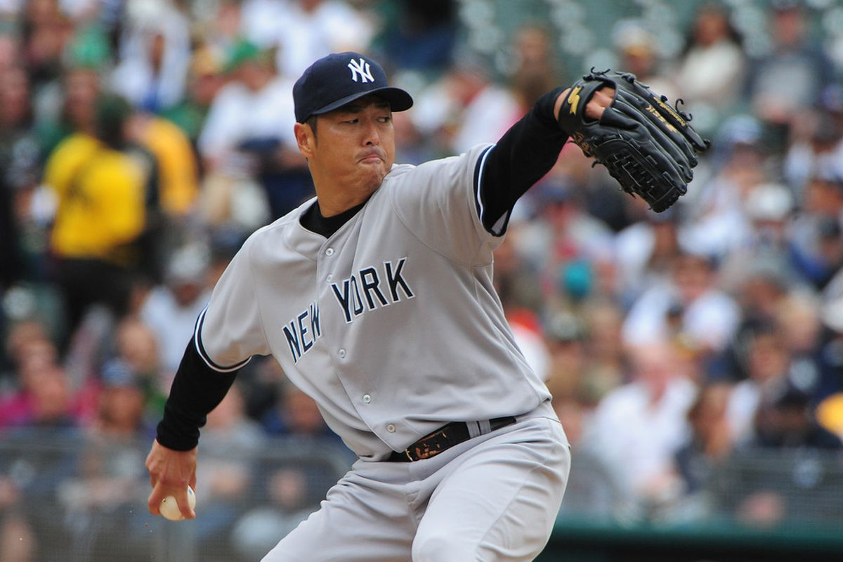 May 27, 2012; Oakland, CA, USA; New York Yankees starting pitcher Hiroki Kuroda (18) delivers a pitch during the first inning against the Oakland Athletics at O.co Coliseum. Mandatory Credit: Kyle Terada-US PRESSWIRE