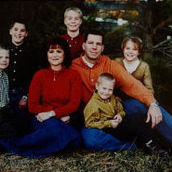 The Jensens in happier times: from left to right, McCray, Parker, mother Barbara, Garrett, father Daren, Emmeron and Taylor.