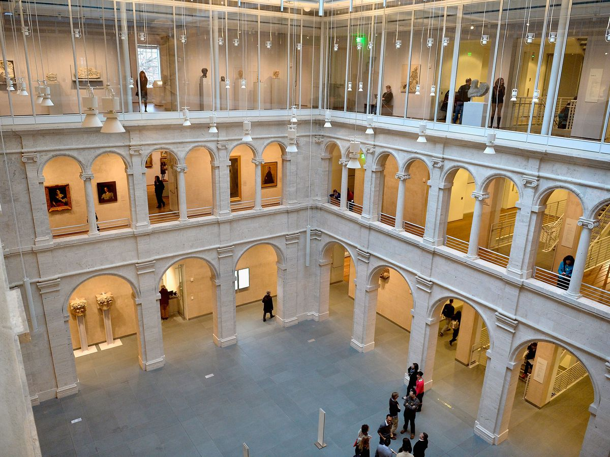 An interior courtyard with a very, very high ceiling and arched walkways running above it on all sides.
