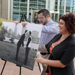Tom Privitere helps photographer Kristina Hill setup a photograph of himself and his partner Brian Edwards outside the federal courthouse in Denver on Wednesday, Sept. 26, 2012. Privitere, Edwards and Hill filed a lawsuit in federal court on Wednesday over the fact that the photo was altered and used in a political campaign in Colorado.