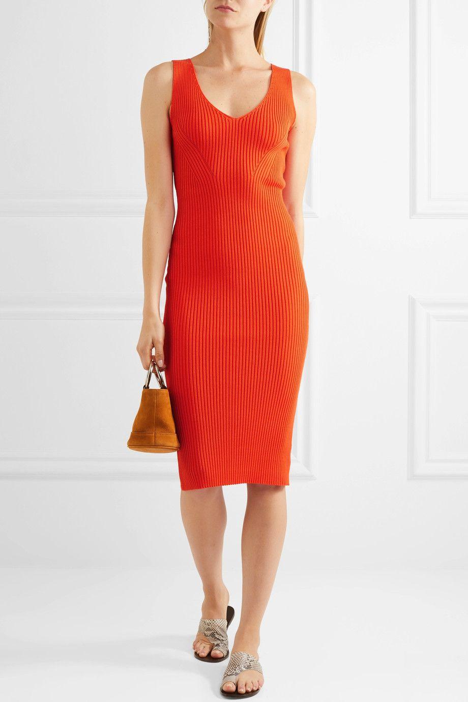 A model wearing a red knit dress
