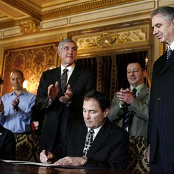 Recently retired Jazz coach Phil Johnson (right) smiles as Gov. Gary Herbert declares March 7 Phil Johnson Day at the Utah State Capitol on Monday, March 7, 2011. Rep. Paul Ray, R-Clearfield, Jerry Sloan, Steve Miller, Gail Miller and the Jazz Bear applaud.