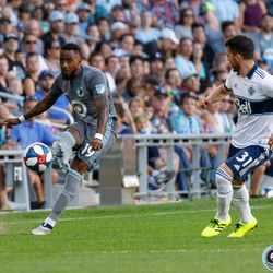 July 27, 2019 - Saint Paul, Minnesota, United States - Minnesota United defender Romain Metanire (19) passes the ball as Vancouver Whitecaps midfielder Russell Teibert (31) rushes in during the match at Allianz Field.