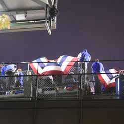 7:53 p.m. The wind catching the bunting, along the back fence of the left field bleachers -