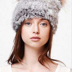 Local designer C/Fan (c-fandesigns.com) has new, hand-knit rabbit fur beanies with raccoon-fur pom poms on top. Photo: via C-FanDesigns.com
