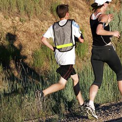 A couple of runners are chased by their shadows as they make their way down the Trappers Loop road in Weber County during the Ragnar Relay Wasatch Back race Saturday.