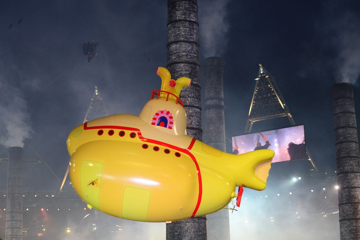 An inflatable yellow submarine floats ab