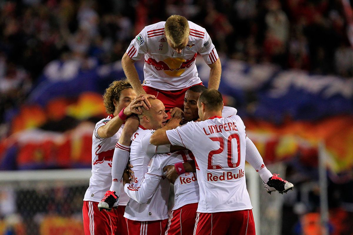 Dane Richards (19) of the New York Red Bulls is congratulated by his teammates after scoring against the Philadelphia Union at Red Bull Arena on October 20, 2011 in Harrison, New Jersey.  (Photo by Chris Trotman/Getty Images)