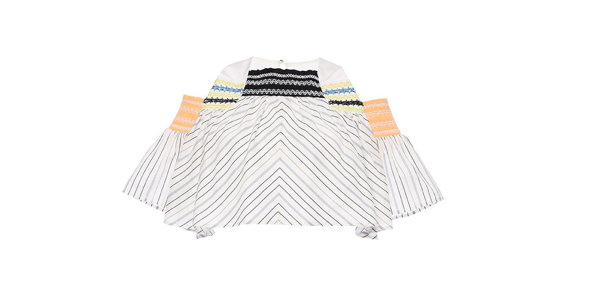 A striped crop top with shoulder cut outs by Peter Pilotto.