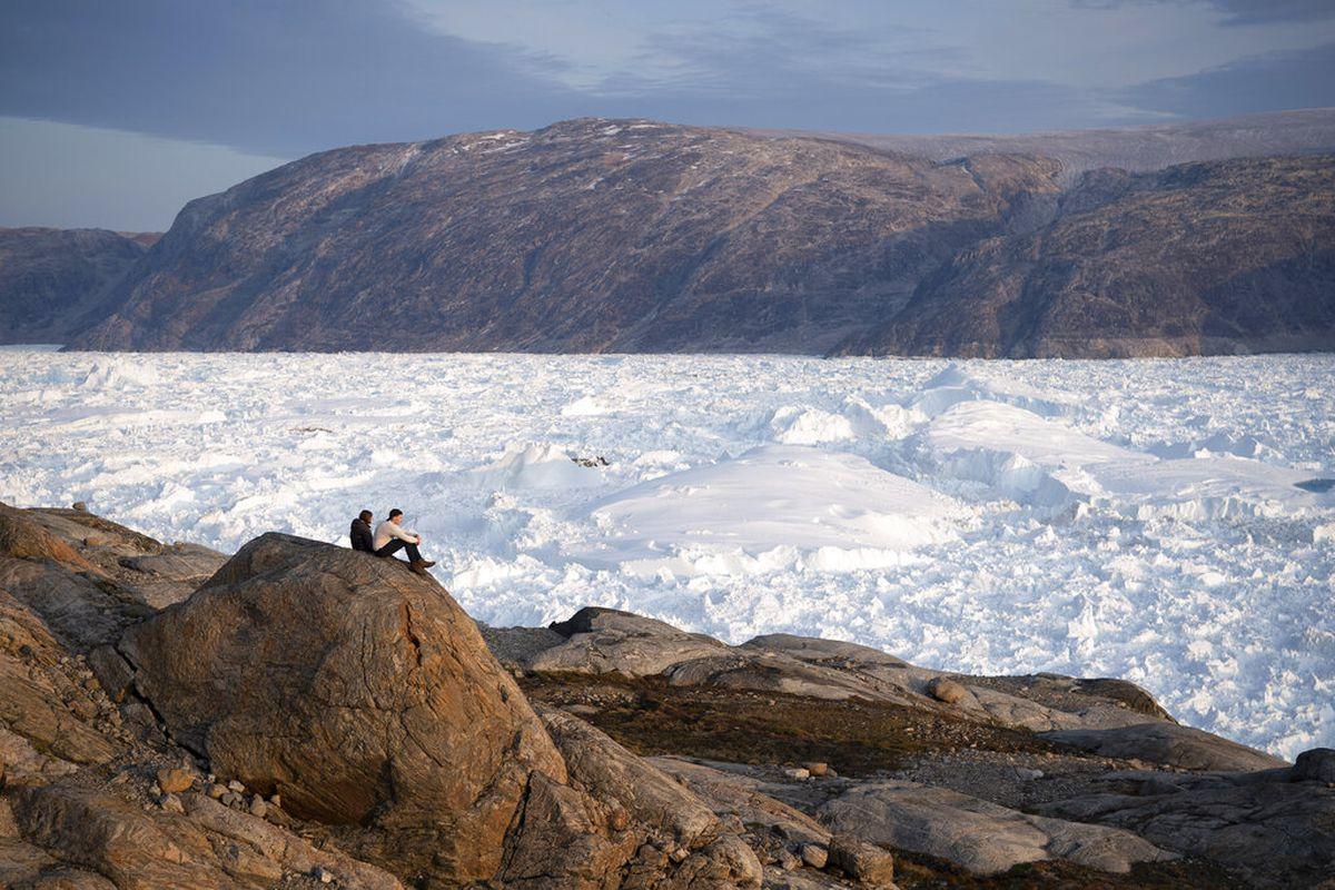 NYU student researchers at the Helheim glacier in Greenland.