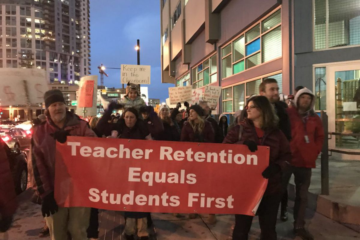 Denver teachers rally for more pay outside a school board meeting  on Jan. 24, 2019.