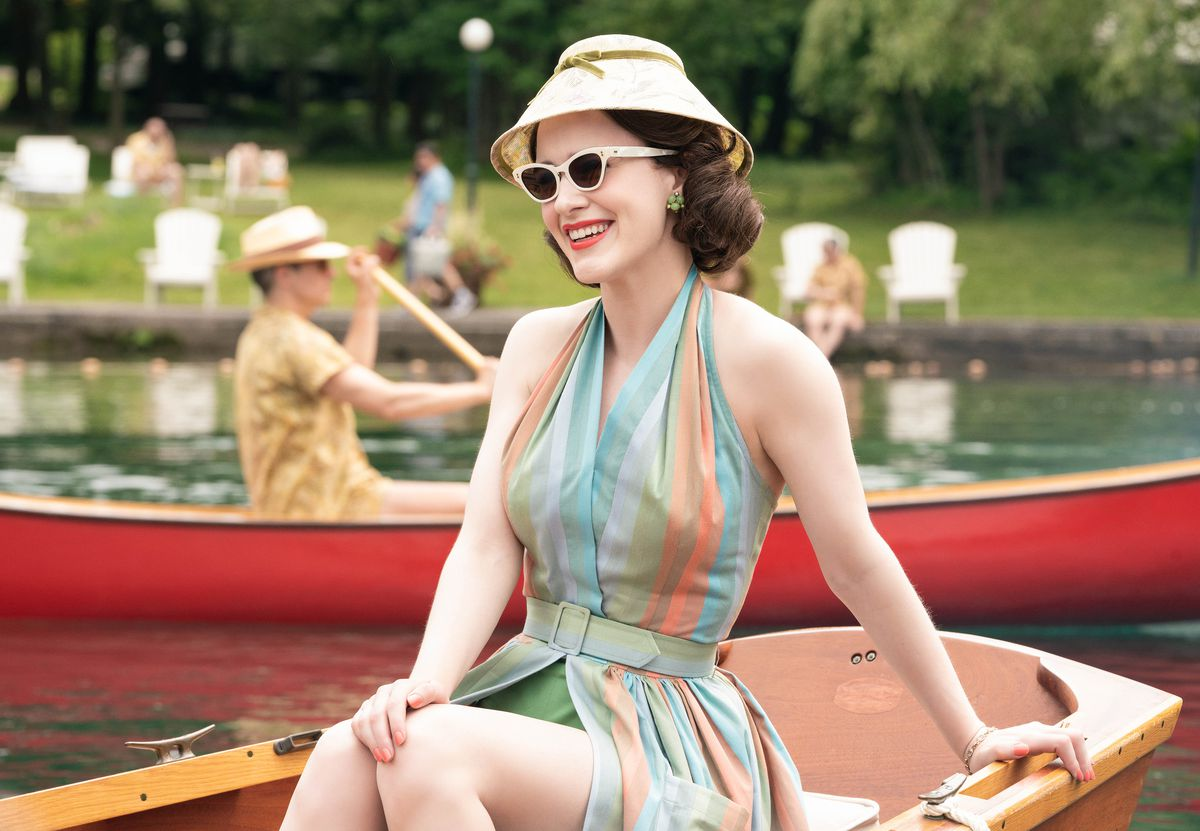 """""""The Marvelous Mrs. Maisel"""" actress Rachel Brosnahan in a rowing boat."""