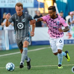 June 25, 2019 - Madison, Wisconsin, United States - Minnesota United defender Chase Gasper (77) breaks away from Forward Madison FC midfielder Brandon Eaton (6) during a friendly match at Breese Stevens Field.