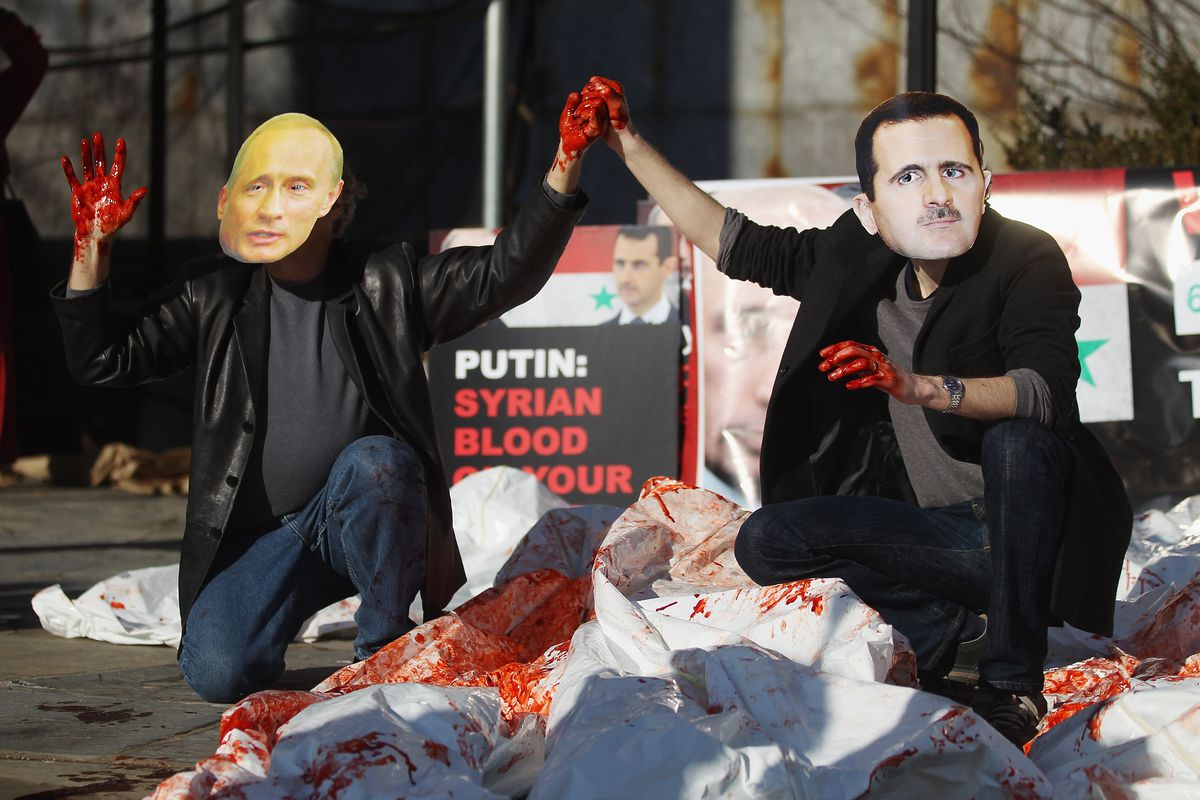 Activists Demonstrate Against Assad And Putin In Front Of The United Nations