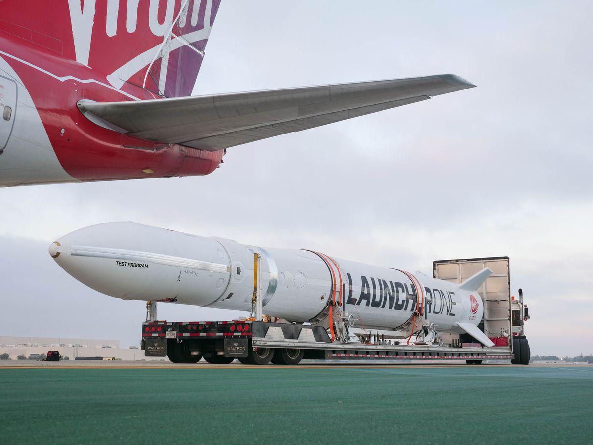 rocket sitting on runway under cloudy skies