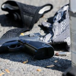 A gun and drug paraphernalia are pictured following an arrest during Operation Rio Grande in Salt Lake City on Monday, Aug. 14, 2017.
