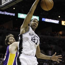 San Antonio Spurs' Tim Duncan (21) dunks as Los Angeles Lakers' Pau Gasol, left, of Spain, defends during the second quarter of an NBA basketball game, Wednesday, April 11, 2012, in San Antonio.