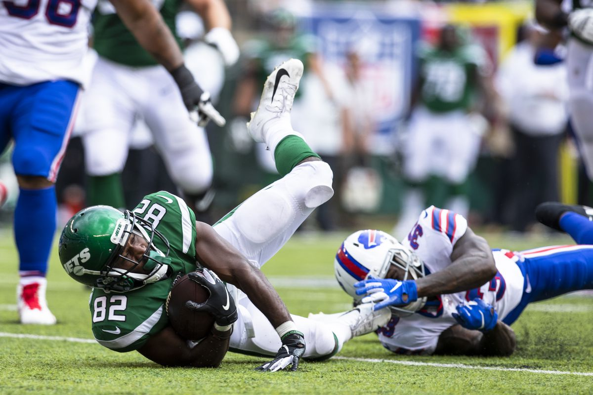 Jamison Crowder of the New York Jets hits the ground after Siran Neal of the Buffalo Bills brings him down during the second half at MetLife Stadium on September 8, 2019 in East Rutherford, New Jersey.