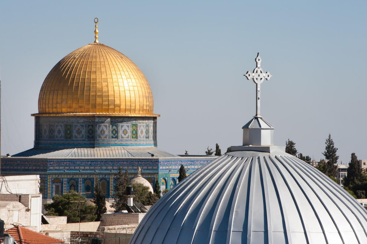 """FILE""""""""The silver dome of Our Lady of the Spasm Armenian Catholic Church and the golden Dome of the Rock rise over the Old City of Jerusalem."""