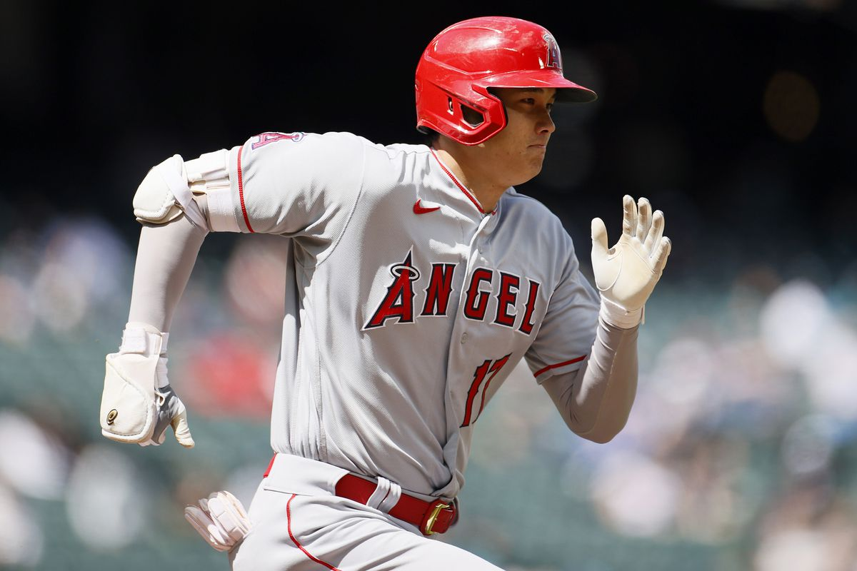 Shohei Ohtani of the Los Angeles Angels runs to first base against the Seattle Mariners during the second inning at T-Mobile Park on May 02, 2021 in Seattle, Washington.