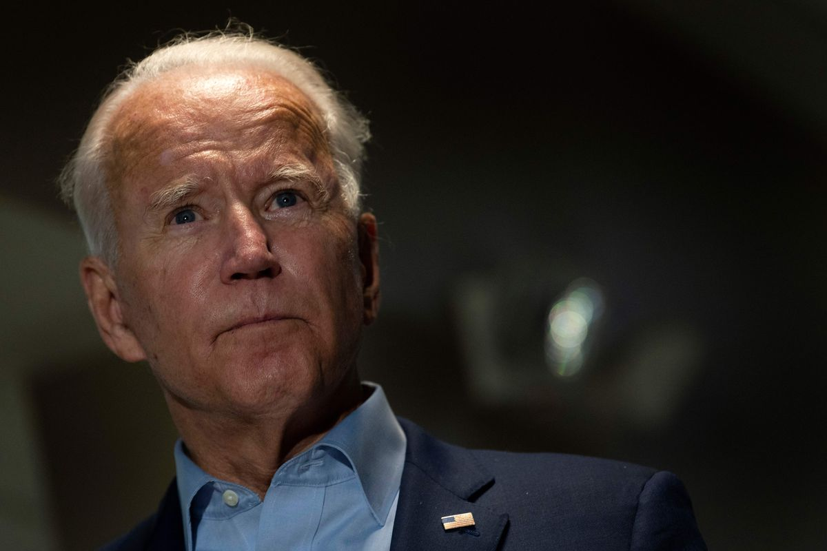 Joe Biden shown from the shoulders up, with a blurred background.
