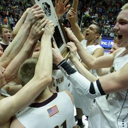 Lone Peak celebrate their win over Alta after the 5A State Championship game in Ogden Saturday, March 2, 2013.