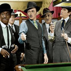 """In the foreground, Sammy Davis Jr., left, Frank Sinatra and Dean Martin, are the Rat Pack members that star in """"Robin and the Seven Hoods"""" (1964), making its Blu-ray debut this week."""