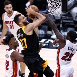Utah Jazz center Rudy Gobert (27) is fouled by Miami Heat guard Kendrick Nunn (25) as he goes up for a shot as the Utah Jazz and the Miami Heat play an NBA basketball game at Vivint Smart Home Arena in Salt Lake City on Saturday, Feb. 13, 2021. Utah won 112-94.