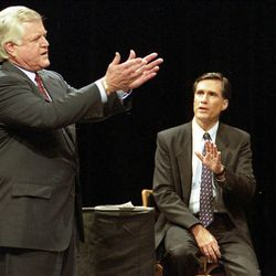Sen. Edward M. Kennedy, D-Mass., left, and Republican challenger Mitt Romney argue while answering a question concerning welfare during a televised debate Oct. 27, 1994, at Holyoke Community College in Holyoke, Mass. Kennedy, the liberal lion of the Senate, died Tuesday after battling a brain tumor. He was 77.