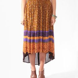 """<a href="""" http://www.forever21.com/Product/Product.aspx?BR=f21&Category=btms_skirts&ProductID=2000040566&VariantID=""""> Forever 21 batik print high-low skirt</a>, $19.90 forever21.com"""