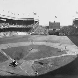 FILE - In this Oct. 4, 1933 file photo, New York Giant's Travis Jackson bunts against Washington Senators pitcher General Crowder during the second inning of Game 2 of baseball's World Series at the Polo Grounds in New York. In clinching a playoff spot, the Washington Nationals put the nation's capital in baseball's postseason for the first time in nearly 80 years.