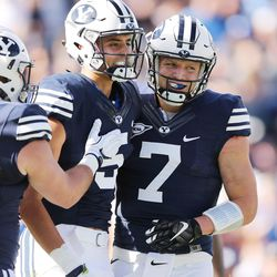 Brigham Young Cougars quarterback Taysom Hill (7) and Brigham Young Cougars wide receiver Nick Kurtz (5) celebrate their touchdown against the Southern Utah Thunderbirds  in Provo on Saturday, Nov. 12, 2016.