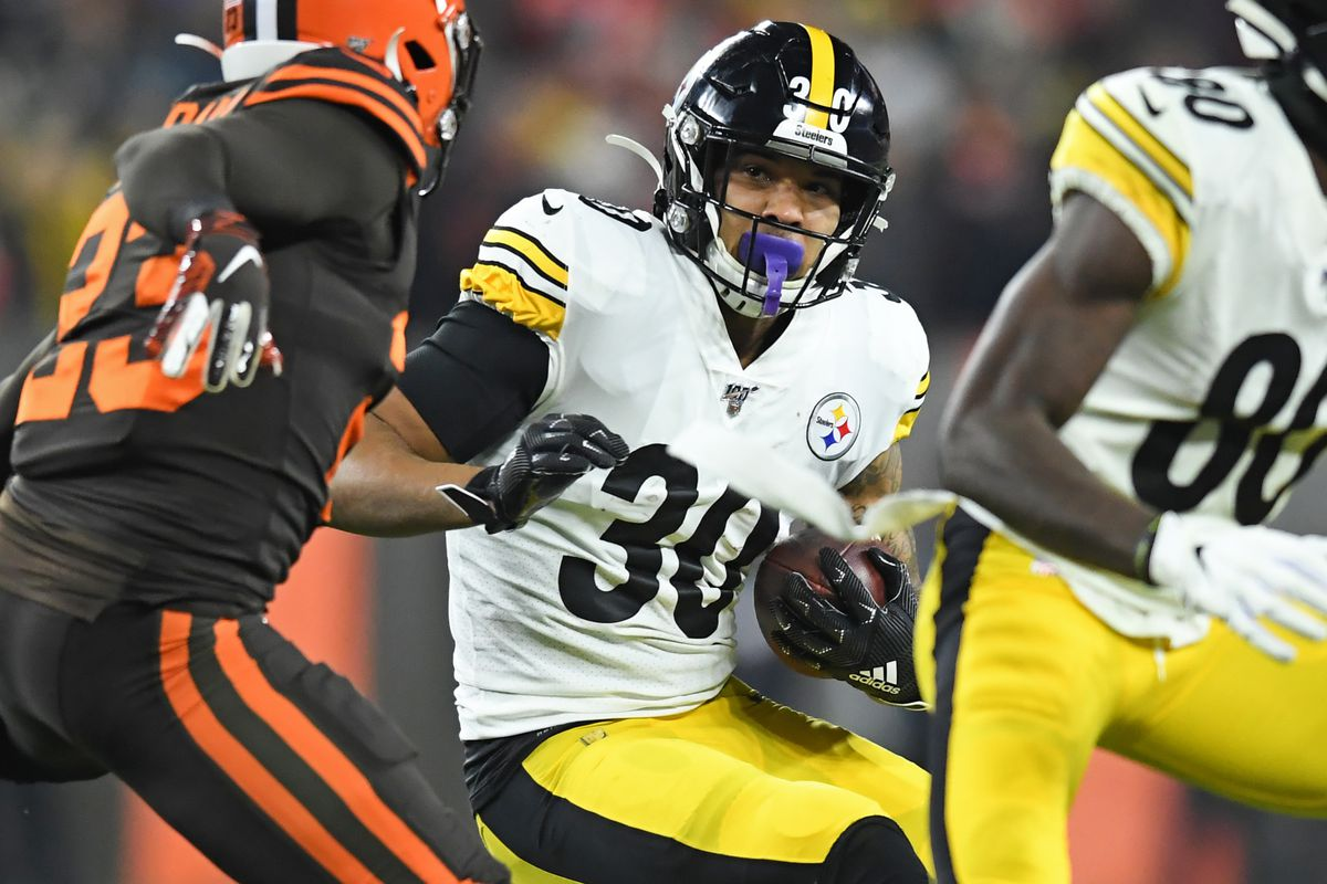 Running back James Conner of the Pittsburgh Steelers carries the ball in the first quarter of a game against the Cleveland Browns on November 14, 2019 at FirstEnergy Stadium in Cleveland, Ohio.